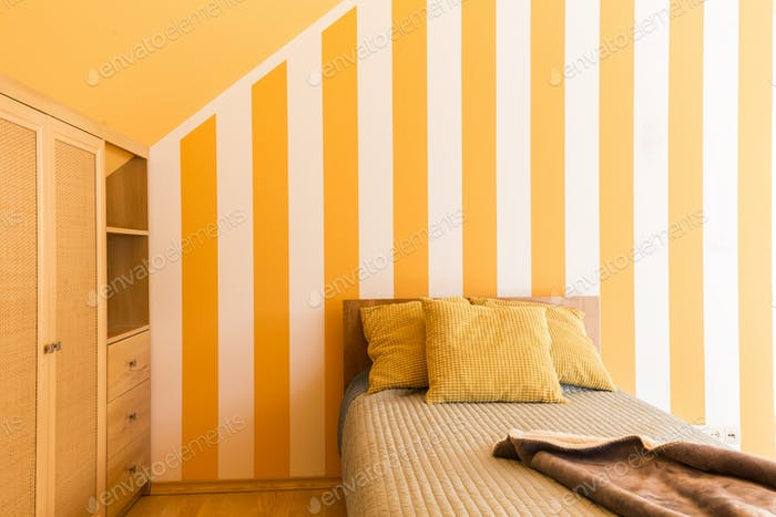 Bed with cushions in yellow interior