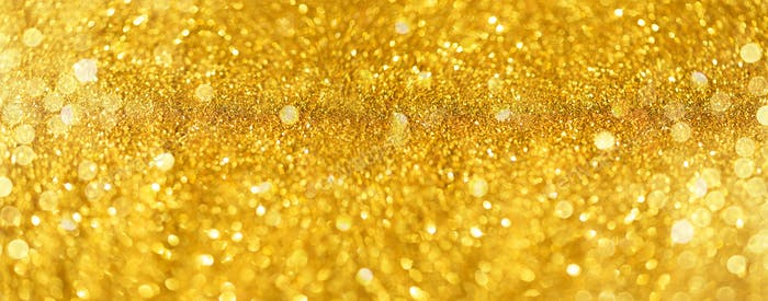 Golden shiny background, copy space for your Christmas greetings. Banner with defocused lights