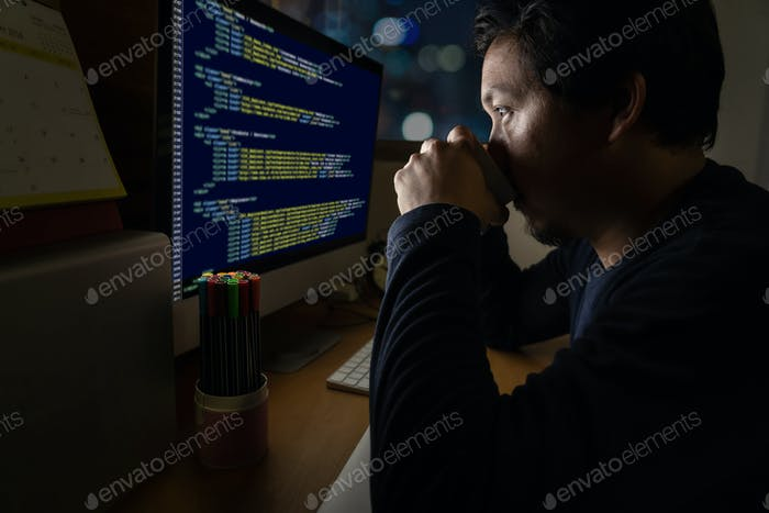 Portrait of Asia Businessman sitting and working hard on the table with programming