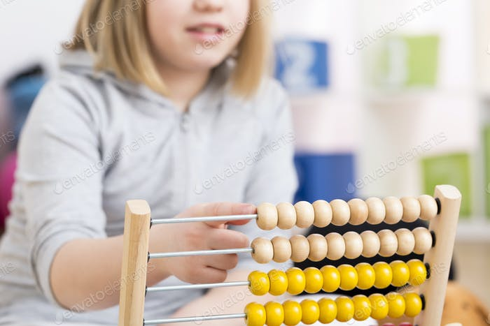 Girl using abacus