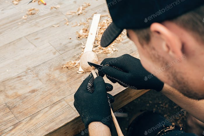 Process of making wooden spoon, chisel and shavings on dirty table