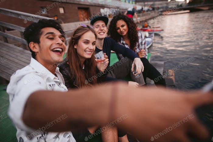 Young people making selfie on a jetty