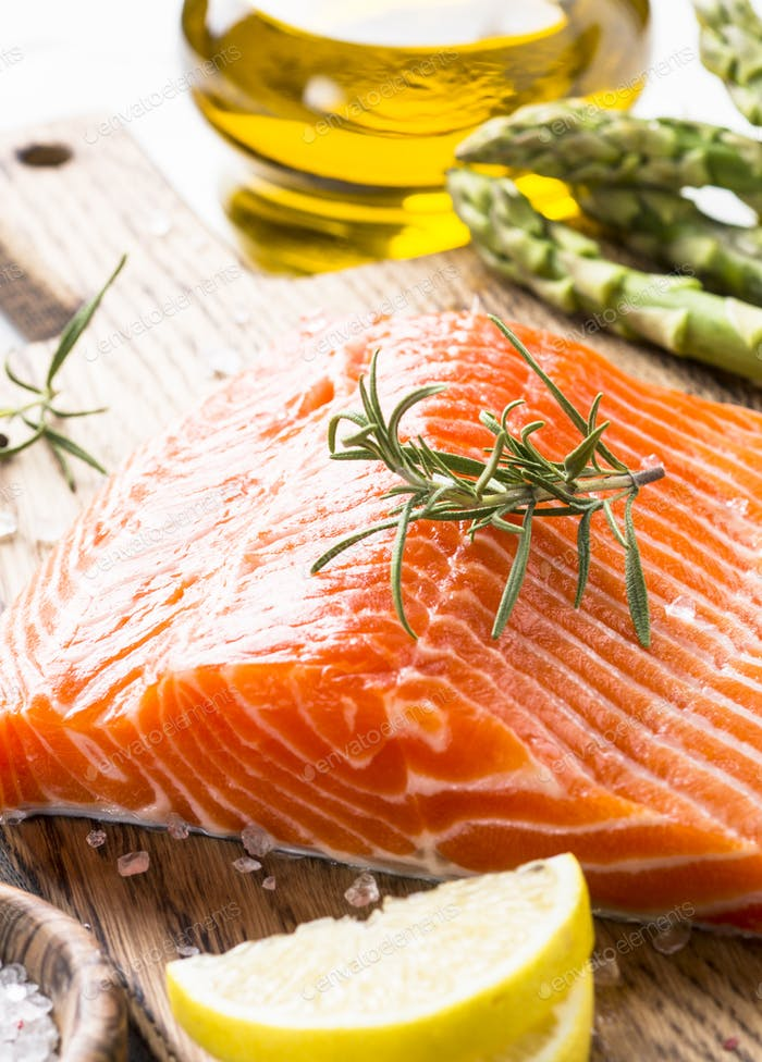 Fresh fish salmon  with lemon sea salt and rosemary on whit