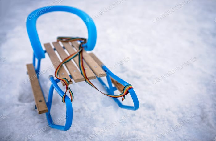 Blue metal and wooden sleds