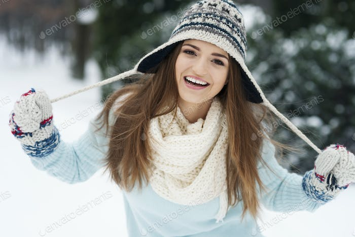 Portrait of smiling beautiful woman in winter time