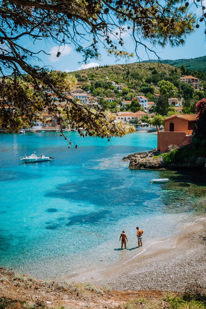 People on summer holiday on beautiful idyllic beach in Kefalonia island of Greece - Europe