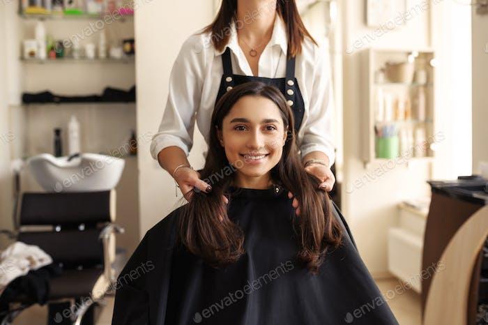 Hairdresser and customer in hairdressing salon