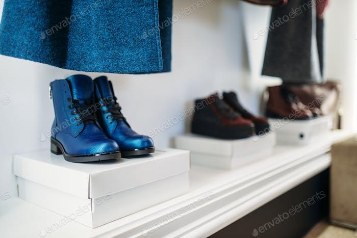 Showcase with stylish female shoes, nobody