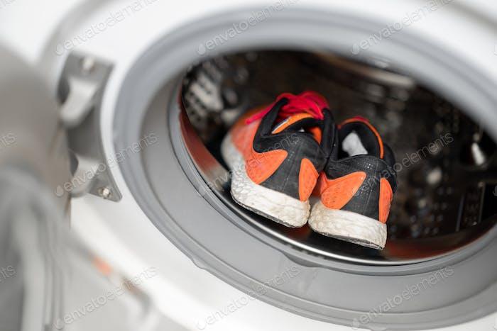 Washing dirty shoes in the washing machine
