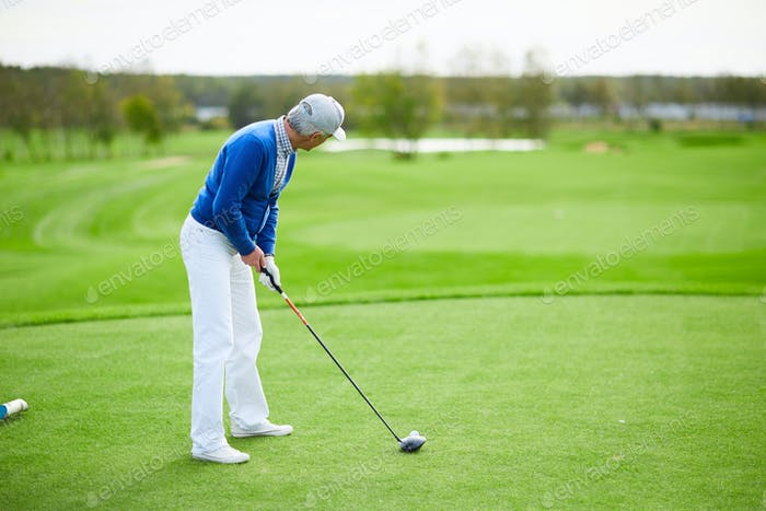 Playing golf on field
