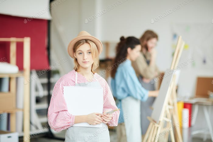 Girl with painting supplies