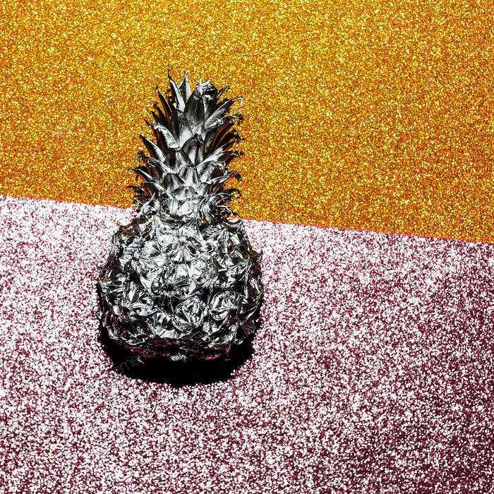 Silver pineapple on a shiny background. Minimal