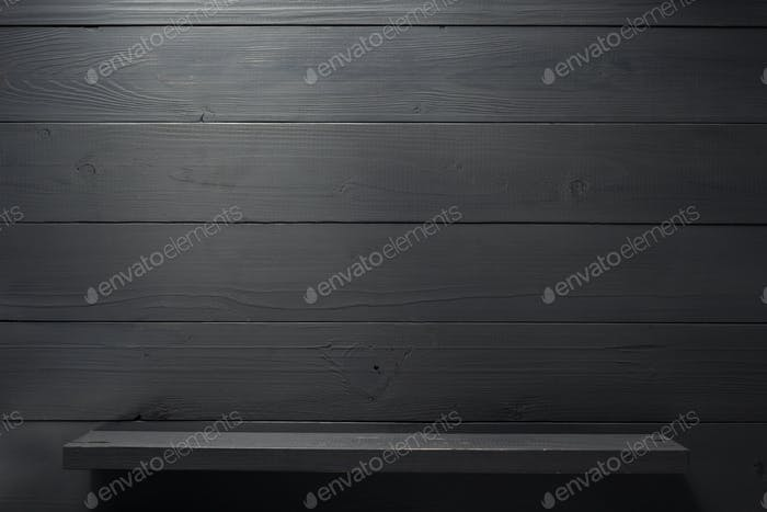 shelf on black wooden background