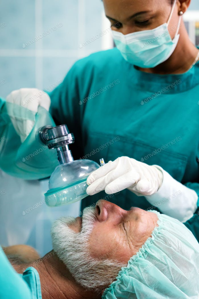 Anesthesiologist doctor anesthetized a surgical patient in hospital