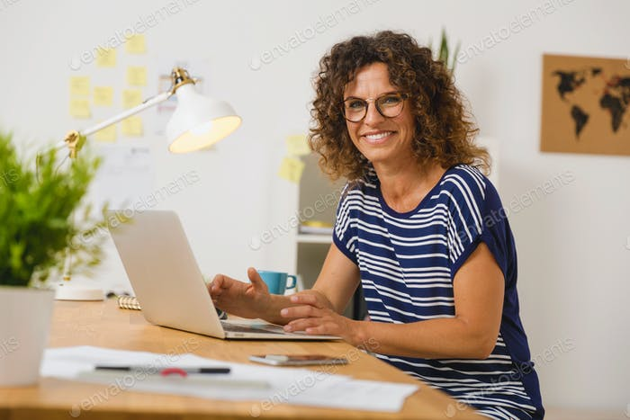 Beautiful woman working at the office