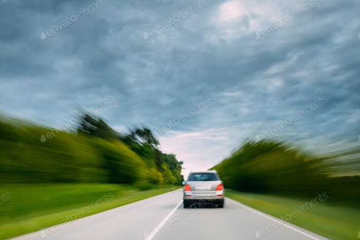 Abstract Natural Blurred Background Of Luxury Suv Car In Fast Mo