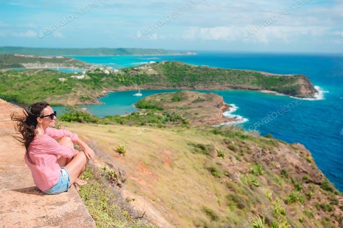 Young woman enjoying breathtaking views of beautiful landscape