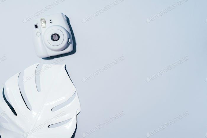 Vilnius, Lithuania - September 16, 2019: FUJIFILM INSTAX Mini Instant Film Camera on grey background