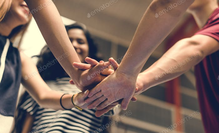 Group of teenager friends on a basketball court teamwork and togetherness concept