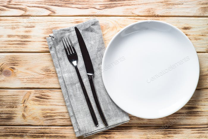 White plate napkin and cutlery