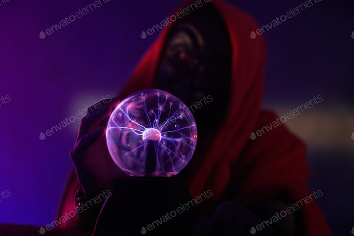 Portrait of wizard with magic globe
