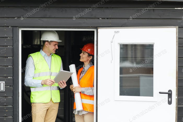 Engineer talking to worker