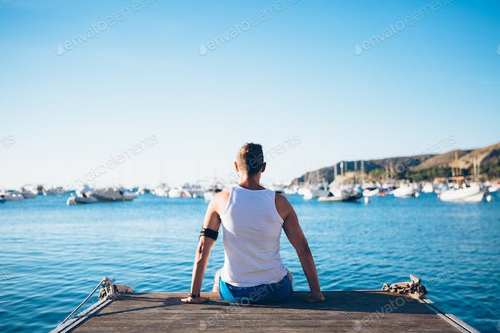 Fit man relaxing on pier