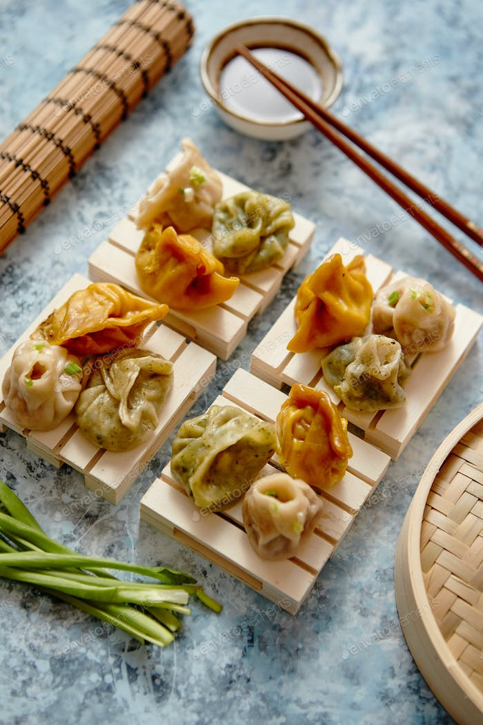 Delicious mixed kinds of chinese dumplings served on wooden stands