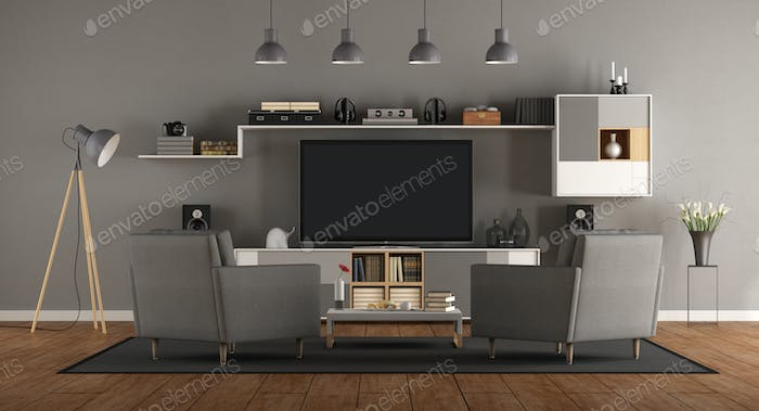 Minimalist gray room with home cinema system
