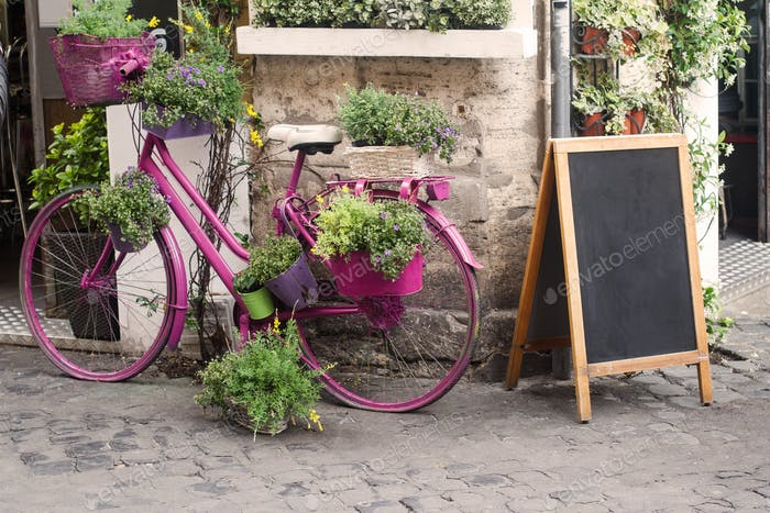 bistro store front with pink bicycle and chalk board