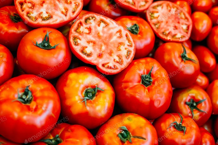 Fresh ripe red  tomatoes forming background