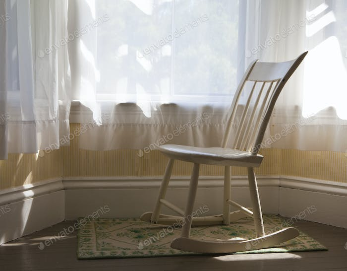 Antique Rocking Chair by a bay window