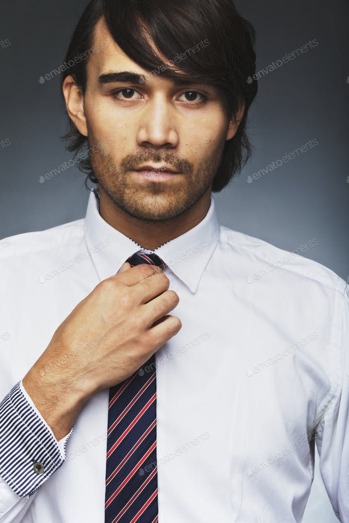 Handsome business executive wearing tie
