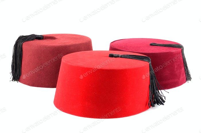 Three red fezzes