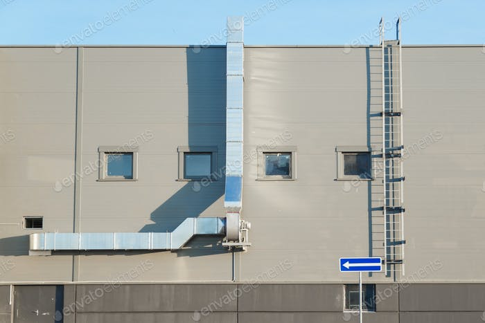 Facade of an industrial building with ventilation