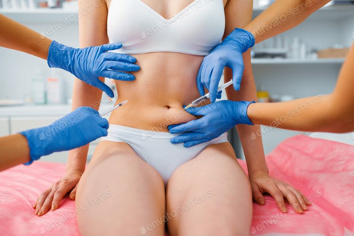 Cosmetician hands gives botox injection in stomach
