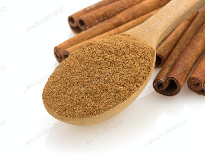 cinnamon in spoon on white