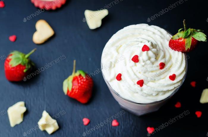 Strawberry hot white chocolate with whipped cream and strawberri