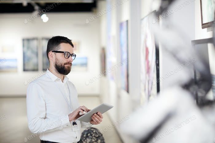 Bearded Man Managing Modern Art Gallery