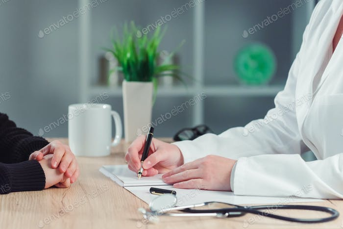Woman making appointment for medical exam at general practitione