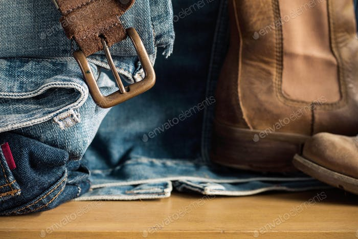 belt and Jeans on wooden