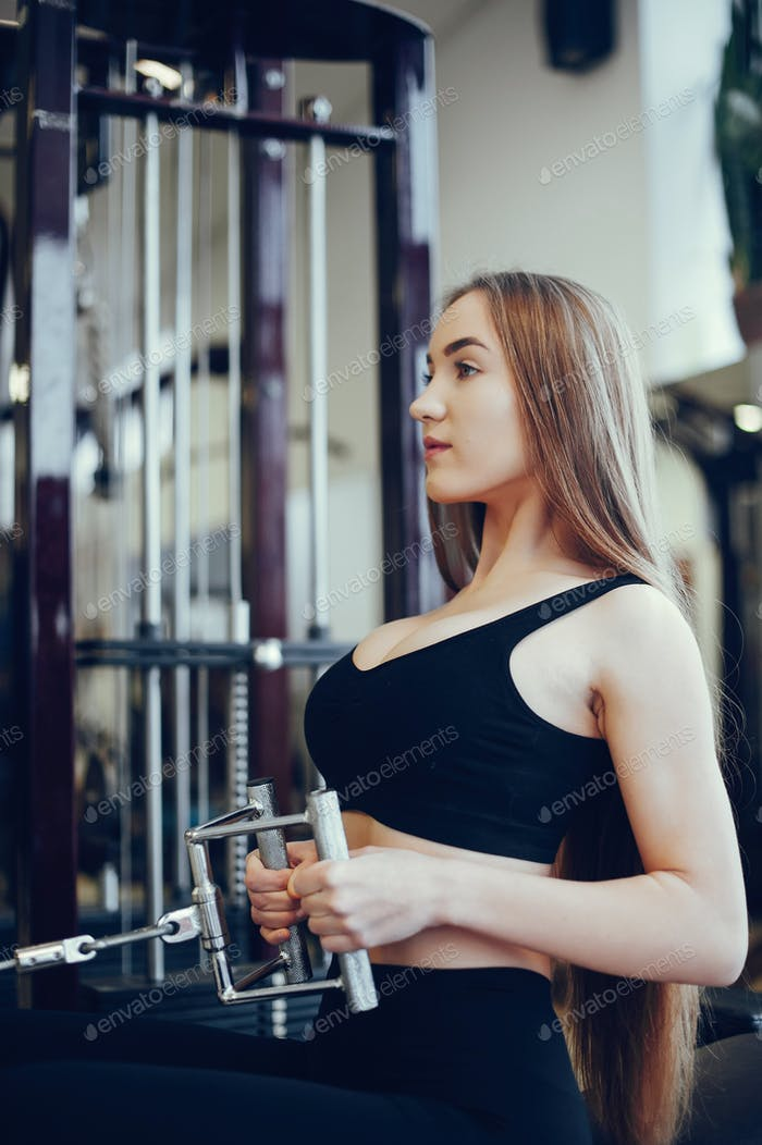 Sports girl in a morning gym