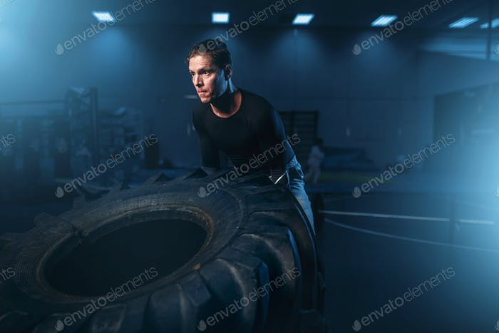 Athlete on training, workout with heavy tire
