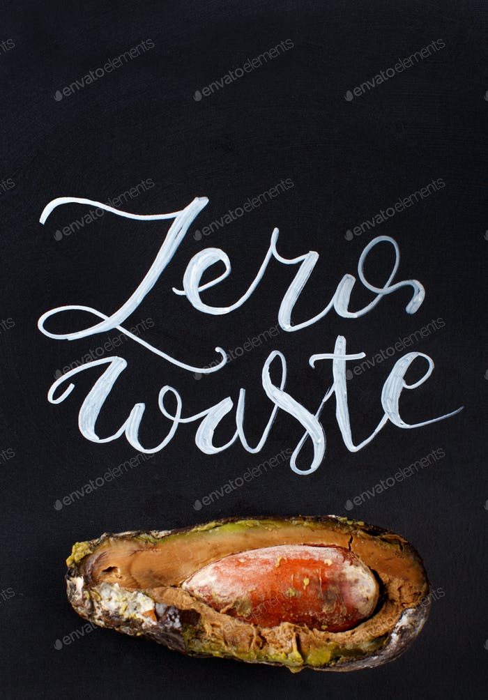 Chalkboard with zero waste lettering and rotten avocado