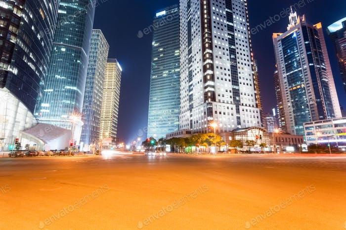 city road with futuristic buildings at night