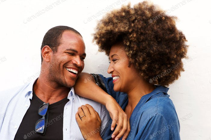 Close up portrait of beautiful couple laughing and standing isol