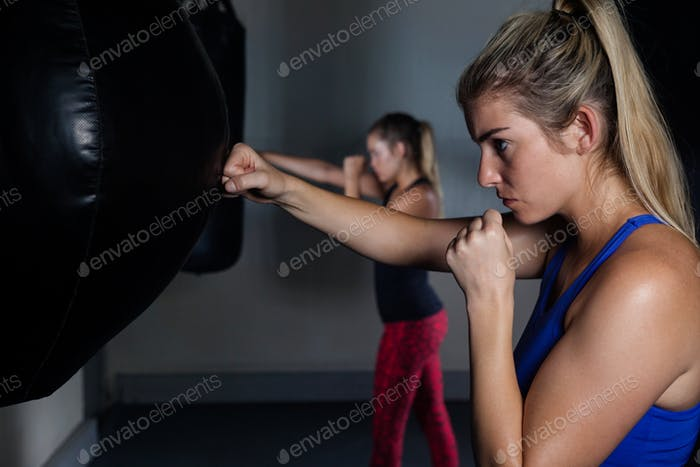 Women practicing boxing in fitness studio