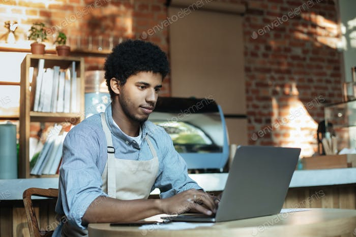 Man owner working and checking email on computer