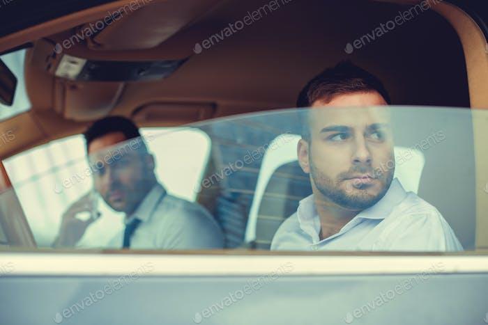 Casual man drives a car.