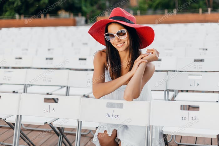 attractive happy smiling woman dressed in white dress